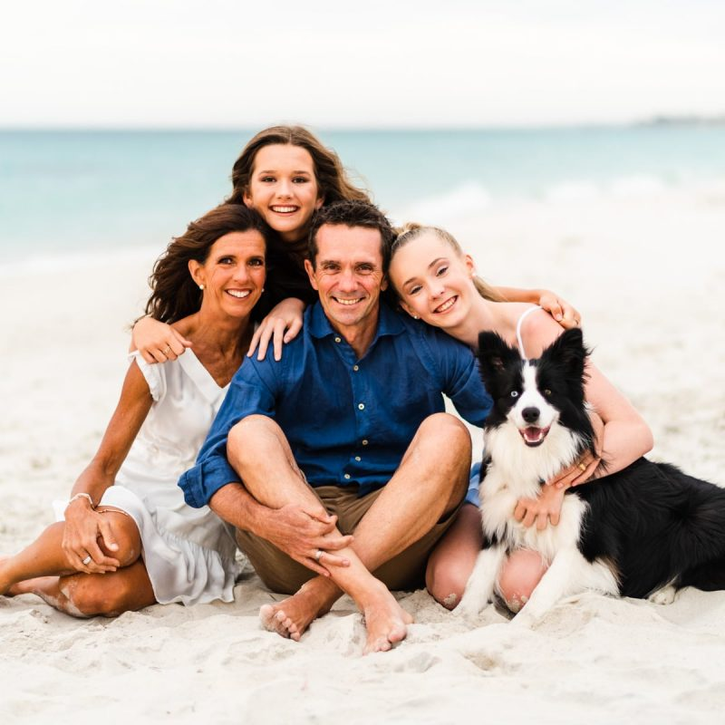 Family Photographs at Sand Tracks beach in Fremantle, Perth taken at sunset with the family dog joining in the action.